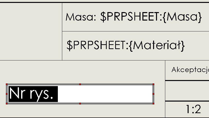 Wyrównanie notatki na środku komórki tabeli rysunkowej
